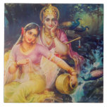 """Radha and Krishna ceramic tile<br><div class=""""desc"""">Vintage calendar image of Radha and Krishna in a romantic mood with a waterfall and peacocks in the background</div>"""