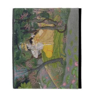 Radha and Krishna embrace in a grove of flowering iPad Folio Covers
