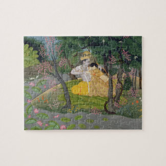 Radha and Krishna embrace in a grove of flowering Jigsaw Puzzle