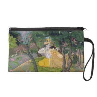 Radha and Krishna embrace in a grove of flowering Wristlet Purse