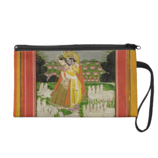 Radha and Krishna embrace in an idealised landscap Wristlet Purses