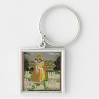 Radha and Krishna embrace in an idealised landscap Keychain