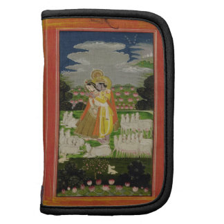 Radha and Krishna embrace in an idealised landscap Folio Planner