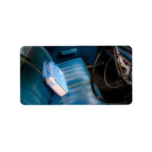 Radio en etiquetas de cuero azules de los asientos etiqueta de dirección