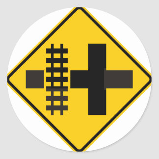 Railroad Parallels Main Road at Crossroad Sign Classic Round Sticker