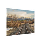 Railroad Tracks Curving Before the Mountains Canvas Print