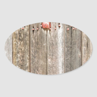Railroad Wood Texture and Red Bolts Oval Sticker