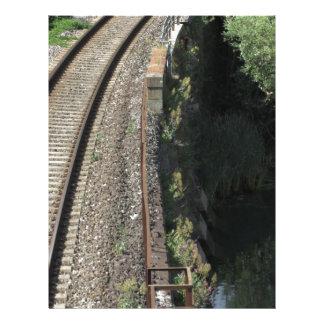 Railway tracks along the river Serchio near Lucca Letterhead