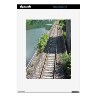 Railway tracks along the river skins for the iPad