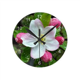 Rain drops on little flower round clock