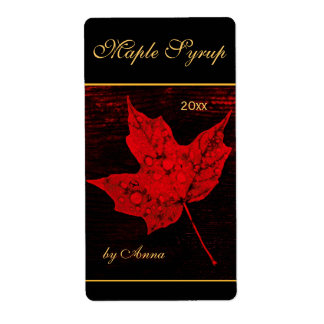 Rain drops on red maple leaf label