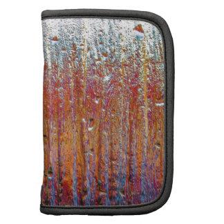 rain on colorful glass folio planners