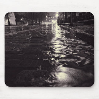 Rain water flowing on the streets of Helsinki Mouse Pad