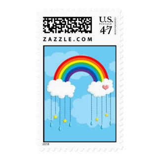 Rainbow and clouds raining stars postage
