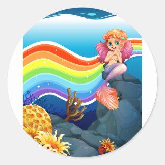 Rainbow and mermaid classic round sticker