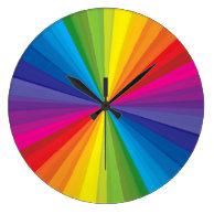 Rainbow Burst Round Clocks on Zazzle