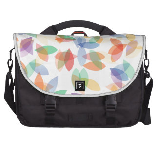 rainbow colored background with leaves commuter bags