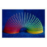 Rainbow-colored slinky toy poster
