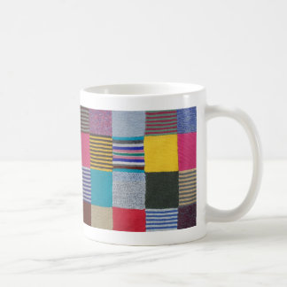 Rainbow colours in knitted check pattern coffee mug