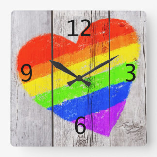 rainbow heart on a grungy wood panel square wall clock
