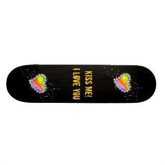 Rainbow heart with asterisks on black skateboard