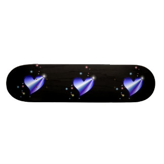 Rainbow heart with asterisks on black skateboard deck