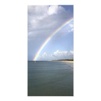 Rainbow over the sea photo card