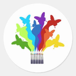 Rainbow paint brushes classic round sticker