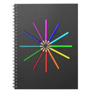 rainbow pencils tips in spiral notebook