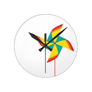 rainbow pinwheel round wall clock
