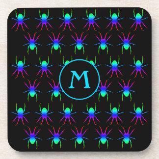 Rainbow spiders monogram on black drink coaster