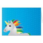 rainbow unicorn party invite on blue backgrouplain card