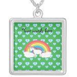 Rainbow unicorn with blue hearts on green pendant