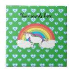 Rainbow unicorn with blue hearts on green tile