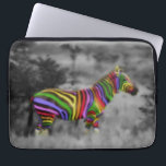 "Rainbow Zebra Laptop Sleeve<br><div class=""desc"">Very cool zebra with rainbow stripes on a black and white photo.  Original digital art by Taylor Addams.</div>"