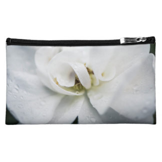 Raindrops on a white rose makeup bag