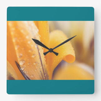 Raindrops on a yellow winter flower square wall clock