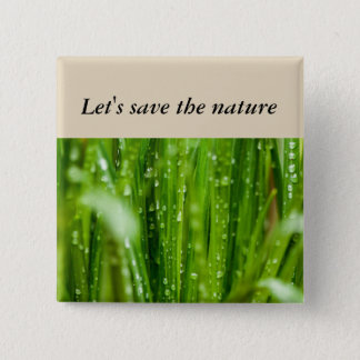 Raindrops on blades of grass pinback button