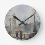 Rainy day in London couple with an umbrella Round Wall Clock