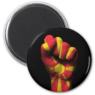 Raised Clenched Fist with Macedonian Flag 2 Inch Round Magnet
