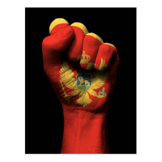 Raised Clenched Fist with Montenegro Flag Postcard