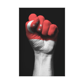 Raised Clenched Fist with Singapore Flag Canvas Print