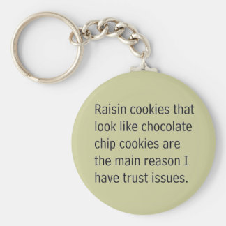 RAISIN COOKIES THAT LOOK LIKE CHOCOLATE CHIPS ARE BASIC ROUND BUTTON KEYCHAIN