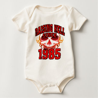 Raising Hell since 1985.png Baby Bodysuit