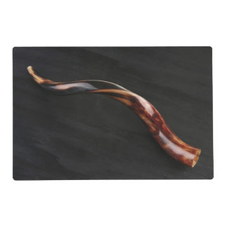 Ram horn ( shofar ) isolated over black placemat