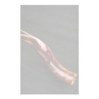 Ram horn ( shofar ) isolated over black stationery
