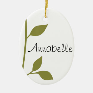 Ramita y hoja adorno navideño ovalado de cerámica