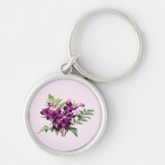 Ramo de orquídeas púrpuras con los helechos llavero redondo plateado