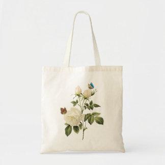 Ramo de rosas blancos con el bolso de las mariposa bolsas lienzo