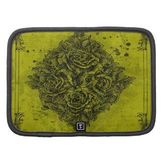 Ramo del vintage de rosas en un fondo amarillo planificadores